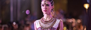 Model wearing Indian dress and headpiece